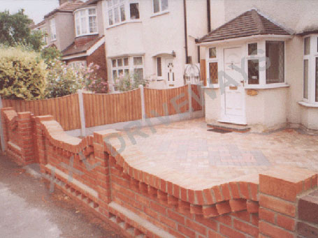 Block paving now block paving patios decking for Front garden wall designs